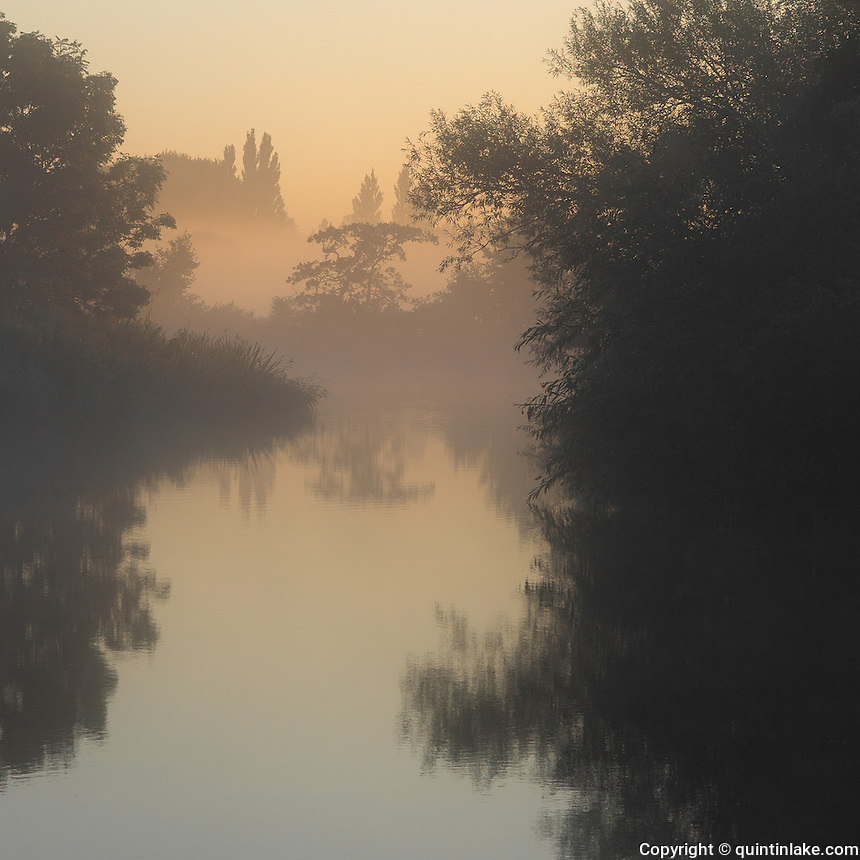 Thames Waters 100 miles downstream (dawn near Shiplake). Thames Path, England, UK