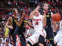Ohio State Buckeyes guard Aaron Craft (4) loses the ball under the basket in the second half of the college basketball game between the Ohio State Buckeyes and the Maryland Terrapins at the Jerome Schottenstein Center in Columbus, Wednesday evening, December 4, 2013. The Ohio State Buckeyes defeated the Maryland Terrapins 76 - 60. (The Columbus Dispatch / Eamon Queeney)