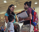 Meli Ocampo talks with a friend while picking her son, Ozzi, up from school at Wyan-Pine Grove Elementary School in London, Ky., on Thursday, Oct. 25, 2012. Ocampo's friend is from Italy and her friend's husband is from Puerto Rico. She and her friend greeted each other with a kiss on the cheek and spoke with each other in Spanish.   Photo by Taylor Moak