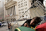 NEW YORK, NY - APRIL 20: A Member of Occupy Wall Street rest on the steps of Federal Hall during a spring training protest on April 20, 2012 in New York City