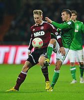 FUSSBALL   1. BUNDESLIGA    SAISON 2012/2013    17. Spieltag   SV Werder Bremen - 1. FC Nuernberg                     16.12.2012 Sebastian Polter (li, 1. FC Nuernberg) gegen Lukas Schmitz (re, SV Werder Bremen)