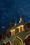 Taj Mahal Casino Hotel, architectural detail of minarets viewed from boardwalk at night in Atlantic City, NJ