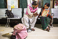 Brinda (right) is counselled by Santwana Manju in between legal team sessions during the preparation for her final witness statement in the Guria office in Varanasi, Uttar Pradesh, India on 22 November 2013. She is one of the 57 underaged and trafficked girls rescued from the Shivdaspur red light area in Varanasi, who has been fighting a court case against her traffickers and brothel owners for the past 8 years.