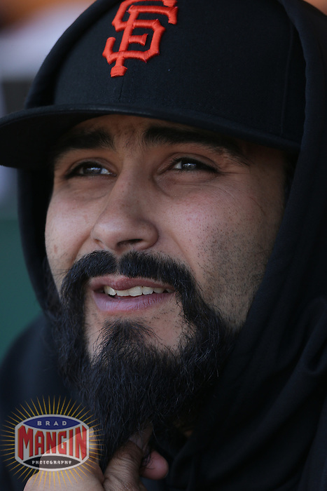 SAN FRANCISCO, CA - MAY 5:  Sergio Romo #54 of the San Francisco Giants sits in the dugout during the game against the Milwaukee Brewers at AT&T Park on Saturday, May 5, 2012 in San Francisco, California. Photo by Brad Mangin