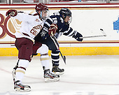 Brendan Silk (BC - 9), Tyler Kelleher (UNH - 16) - The Boston College Eagles defeated the visiting University of New Hampshire Wildcats 6-2 on Friday, December 6, 2013, at Kelley Rink in Conte Forum in Chestnut Hill, Massachusetts.