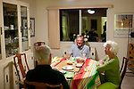 "Bonnie and Jim Hines share dinner with new neighbor Noren Shanley (center) in the Hines' Sun City home December 8, 2010..""It's gentle, it's quiet,"" she said of Sun City. ..2010 marks the 50th anniversary of Sun City, America's first retirement city that remains the largest today with more than 40,000 residents 55 and older."