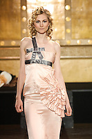 Model walks runway in a Magdalena Adriane outfit, by Magdalena Adriane Toth, during the Slovak Fashion Night fashion show, May 13, 2011.