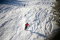 Skiers and snowboarders on the hill at Showdown Ski Area on King's Hill in the Little Belt Mountains near Neihart, Montana, USA.