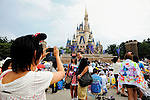 Tourists from Guam have their picture taken at Tokyo Disneyland in Chiba, east of Tokyo, Japan.
