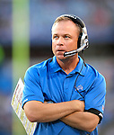 3 September 2009:  Detroit Lions' offensive coordinator Scott Linehan watches a play during a pre-season game against the Buffalo Bills at Ralph Wilson Stadium in Orchard Park, New York. The Lions defeated the Bills 17-6...Mandatory Photo Credit: Ed Wolfstein Photo