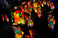 Colorful paper lanterns, depicting birds from tropical rainforests of Amazonia, illuminate the street during the annual Festival of Candles and Lanterns in Quimbaya, Colombia, 8 December 2013. A vibrant event, celebrated since 1982 and attracting tens of thousands of visitors every year, is held in honor of the Virgin Mary, on the day of the Catholic Feast of the Immaculate Conception. Each street and neighborhood in the town compete in the contest to create the most spectacular lighting arrangement of their place, employing creatively elaborated lantern designs, which range from religious themes, to symbols of the coffee region or the environmental and wild nature motives. All the streets in Quimbaya center close for one night and some 40,000 lanterns are being lightened up at the festive night.