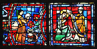 Fulbert studying medicine (left) surrounded by ingredients and plants used to make potions, and Fulbert anointed Holy Bishop by the king Robert the Pious (right), from the Life of Fulbert stained glass window, in the south transept of Chartres Cathedral, Eure-et-Loir, France. This window replaces the original 13th century window depicting the Life of St Blaise, which was destroyed in 1791. It was created in 1954 by Francois Lorin as a gift of the Institute of American Architects, on a theme chosen by the Canon Yves Delaporte. It depicts the life of Fulbert, bishop of Chartres in the 11th century. Chartres cathedral was built 1194-1250 and is a fine example of Gothic architecture. Most of its windows date from 1205-40 although a few earlier 12th century examples are also intact. It was declared a UNESCO World Heritage Site in 1979. Picture by Manuel Cohen