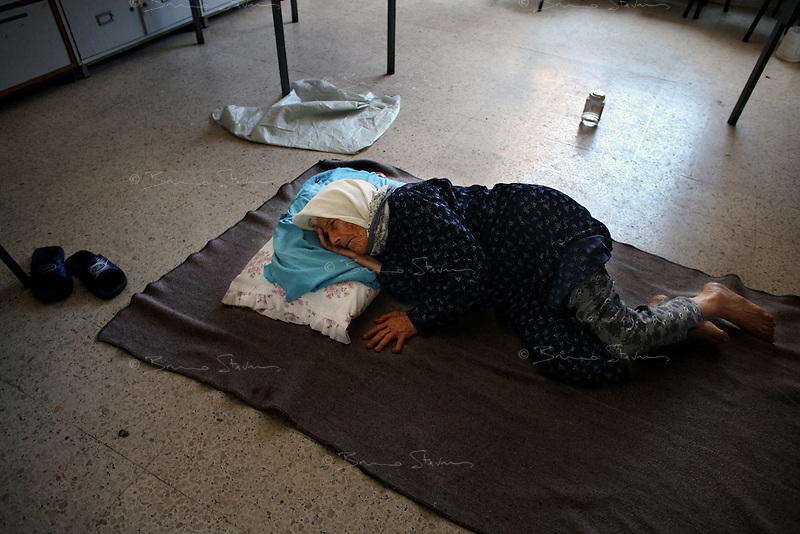 Tyr, Lebanon, Aug 4 2006.Hajj Mariama school (St. Mary), Hundreds of refugees from Shatiyeh, a nearby village heavily bombarded by the Israeli arrived only with the clothes they were wearing as they fleeed their destroyed homes in a hurry. Subhaya Musilmeen, 90 has to sleep on a classroom concrete floor.