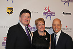Lynn & Samuel Auxier greet Scott Hamilton- Figure Skating in Harlem celebrates 20 years - Champions in Life benefit Gala on May 2, 2017 in New York Ciry, New York.   (Photo by Sue Coflin/Max Photos)