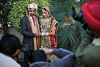 A newly married couple pose for photographs at Grewal Farms, one of many wedding reception centres in Amritsar.