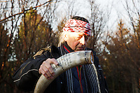 Eyvindur P. Eiríksson priest (or gothi) of Iceland's neo-pagan Asatru association offers the deities his offering from a horn.