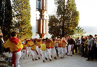 Gubbio 15 MAY 2004..Festival of the Ceri..The last stretch of the race winds all the way up the stony mountain road in a mere 10 minutes the stretch is run, still with the Ceri being carried on the shoulders. The Cero of St St Ubaldo..http://www.ceri.it/ceri_eng/index.htm....http://www.ceri.it/ceri_eng/index.htm..