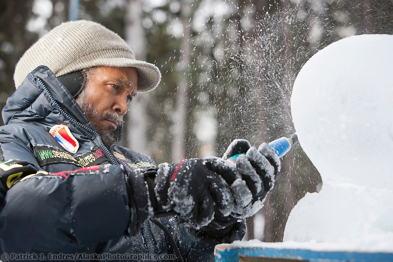 """French sculptor Steve Armance, carves away on a single block, realistic sculpture titled """"Eternal Flame"""" during the 2009 World Ice Art Championships in Fairbanks, Alaska."""