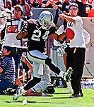 Oakland Raiders vs. San Diego Chargers at Oakland Alameda County Coliseum Sunday, September 3, 2000.  Raiders beat Chargers  9-6.  Oakland Raiders defensive back Charles Woodson (24).