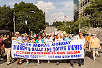 July 13, 2015. Winston Salem, North Carolina.<br />  Marchers hike up a downtown street at the start of the march to support the NC NAACP's voting rights case against Gov. Pat McCrory.<br />  To rally support for the North Carolina NAACP's case against Gov. Pat McCrory (NC NAACP v. McCrory), a march was held in downtown Winston Salem on the opening day of the case in federal court. Thousands gathered to walk the streets of downtown and listen to speeches proclaiming the importance of defeating new requirements for voter registration,<br />  The NC NAACP contests that HB 589 (Voter ID requirements) violate Section 2 of the Voting Rights Act (42 U.S.C. 1973) and the Fourteenth and Fifteenth Amendments of the Constitution.