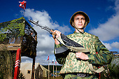 A Pro-Putin Nashi youth guards a Nashi army base at a summer camp on Lake Seliger in Russia. The yearly camp, organised by the nationalistic group, trains youth in political activism.