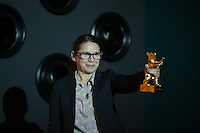 "Movie director Ildiko Enyedi of Hungary holds her new Golden Bear won by movie ""On Body and Soul"" during a press conference in Budapest, Hungary on February 21, 2017. ATTILA VOLGYI"