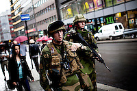 Oslo, Norway, 23.07.2011. Soldiers in the streets. The morning in Oslo was dedicated to cleaning up shattered glass all over the city. Oslo awakes to shocking messages of the total bodycount after yesterdays massacre. A total of 91 persons were killed in the massacre in Utøya right outside Oslo. Seven of those died when a car bomb was detonated outside the main government biuilding in the heart of Oslo, friday 22. of July. Foto: Christopher Olssøn.