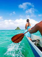 "Canoe approaching the island Mokoli'i, ""Chinamans Hat"" offshore from Kane'Ohe Bay, Hawai?i"