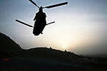 A Canadian CH-47 Chinook helicopter takes off at sunset from a base in the Arghandab valley near Kandahar, Afghanistan. With NATO preparing a major offensive around the city, much of the groundwork is being laid in the Arghandab and other neaby districts. March 22, 2010. DREW BROWN/STARS AND STRIPES