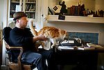 """Writer and poet August Kleinzahler, 60, reviews his work in the living room where he works a typewriter and desk, at his home, in San Francisco, Ca., on Friday, February 6, 2008. Kleinzahler recently published his tenth collection of poetry, """"Sleeping it off in Rapid City"""" last year."""