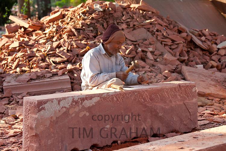 Stonemason using traditional manual skills at stone workshop at Humayuns Tomb,  in New Delhi, India