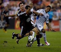 Scott Sealy (9) of San Jose fights for the ball with Jed Zayner (12) of D.C. United during a game at RFK Stadium in Washington, DC.  San Jose defeated D.C. United, 2-0.