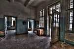 Abandoned lunatic asylum north of Berlin, Germany. Empty room with open doors.