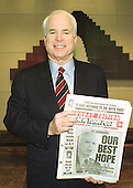 Washington, DC - (FILE) -- United States Senator John McCain (Republican of Arizona) holds a copy of the New York Post showing their endorsement of his candidacy for the 2000 Republican nomination for President of the United States on February 27, 2000.  McCain also received the paper's endorsement in the 2008 New York Republican Presidential Primary..Credit: Ron Sachs / CNP