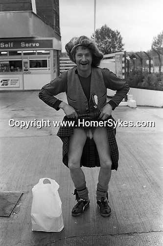 Scotland comes to Wembley. A Scottish football fan shows me what a Scotsman  has under his kilt. London England 1981.