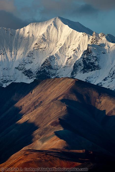 Fresh snow fall on the ridges of the Alaska range mountain, autumn colored tundra, Polychrome mountains, Denali National Park.
