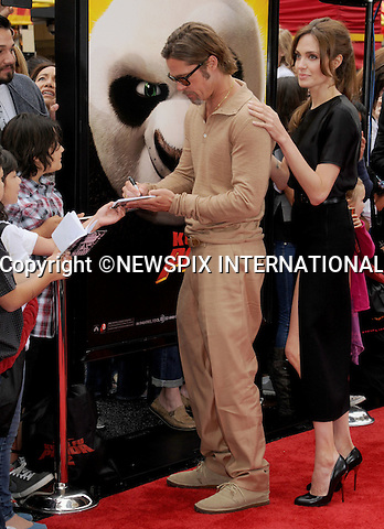 """ANGELINA JOLIE AND BRAD PITT .attend the Los Angeles Premiere of """"Kung Fu Panda 2"""" at the Grauman's Chinese Theatre, Hollywood, California_22/05/2011.Mandatory Photo Credit: ©Crosby/Newspix International..**ALL FEES PAYABLE TO: """"NEWSPIX INTERNATIONAL""""**..PHOTO CREDIT MANDATORY!!: NEWSPIX INTERNATIONAL(Failure to credit will incur a surcharge of 100% of reproduction fees)..IMMEDIATE CONFIRMATION OF USAGE REQUIRED:.Newspix International, 31 Chinnery Hill, Bishop's Stortford, ENGLAND CM23 3PS.Tel:+441279 324672  ; Fax: +441279656877.Mobile:  0777568 1153.e-mail: info@newspixinternational.co.uk"""