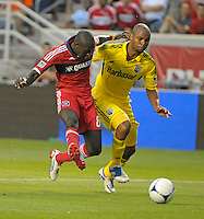 Chicago forward Dominic Oduro (8) shoots in front of Columbus defender Julius James (26), scoring Chicago's second goal. The Chicago Fire defeated the Columbus Crew 2-1 at Toyota Park in Bridgeview, IL on June 23, 2012.