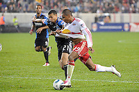 Juan Agudelo (39) of the New York Red Bulls is defended by Jason Hernandez (21) of the San Jose Earthquakes. The San Jose Earthquakes defeated the New York Red Bulls 3-1, (3-2) on aggregate during the 2nd leg of the Major League Soccer (MLS) Eastern Conference Semifinals at Red Bull Arena in Harrison, NJ, on November 04, 2010.