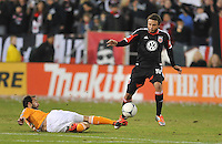 D.C. United midfielder Nick DeLeon (18) goes against Houston Dynamo midfielder Brad Davis (11) D.C. United tied The Houston Dynamo 1-1 but lost in the overall score 4-2 in the second leg of the Eastern Conference Championship at RFK Stadium, Sunday November 18, 2012.
