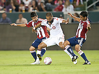 CARSON, CA – OCTOBER 9: Chivas USA players Paolo Nagamura (26) and Michael Umana (4) battle Toronto FC forward Maicon Santos (29) during a soccer match at Home Depot Center, October 9, 2010 in Carson California. Final score Chivas USA 3, Toronto FC 0.