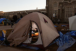 January 23, 2013. Durham, North Carolina. Jack Clark, a junior from Washington, DC, studies in his tent in K-Ville where students camp out to get tickets for home basketball games at Cameron Indoor Stadium. Students stay for weeks leading up to the game versus arch rival UNC.. Duke University has become a power house in the national college basketball arena under the coaching of head coach Mike Krzyzewski. But the university has fought hard to maintain its image of high academic achievement while riding the wave of collegiate athletic success.