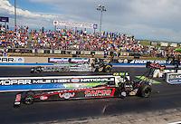 Jul 26, 2015; Morrison, CO, USA; NHRA top fuel driver Steve Torrence (near) races alongside Larry Dixon during the Mile High Nationals at Bandimere Speedway. Mandatory Credit: Mark J. Rebilas-USA TODAY Sports