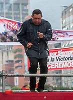 Venezuela: Caracas,04/10/11 .Venezuelan President Hugo Chavez dance as gives a speech to his followers, under heavy rain, during the closing rally of his campaign in Caracas, three days after the presidential elections on October 7, where he seeks reelection for a further period of six years, after 14 years ruling Venezuela...Carlos Hernandez/Archivolatino
