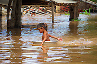 Little Girl using a bathtub for getting around during the Monsoon season on the Tonle Sap lake Cambodia