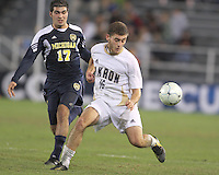 Chris Korb #16 of the University of Akron shields the ball from Hamoody Saad #17 of the University of Michigan during the 2010 College Cup semi-final at Harder Stadium, on December 10 2010, in Santa Barbara, California. Akron won 2-1.