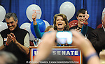 At center, United States Senator Lisa Murkowski (R) Alaska encourages supporters Tuesday Nov. 2, 2010 with election returns showing her write in campaign showing promise.   (AP Photo/Michael Dinneen)