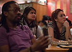 Audience members listen to performers during a social justice-themed open mic night at Casa Nueva on Jan. 21, 2015. Photo by Lauren Pond