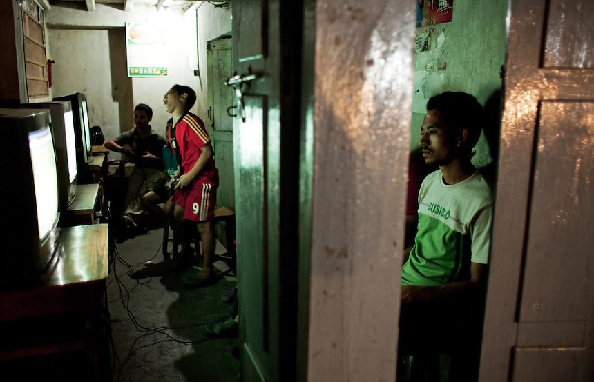Young Nepalis play computer games at a small gaming parlour in Kathmandu, Nepal, August 2011. Photo: Ed Giles.