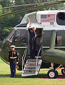 United States President Bill Clinton waves from the top step of Marine 1 on the South Lawn of the White House on Thursday, August 19, 1999.  The First Family are to vacation for 2 weeks in Martha's Vineyard.  On Tuesday, August 17, 1999, the President testified before the Grand Jury on his involvement in the Monica Lewinsky scandal and subsequently made a nationally televised statement admitting he had an inappropriate relationship with Ms. Lewinsky.<br /> Credit: Ron Sachs / CNP
